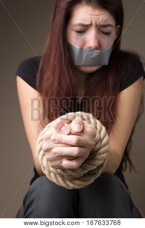 Miserable victim with sealed mouth