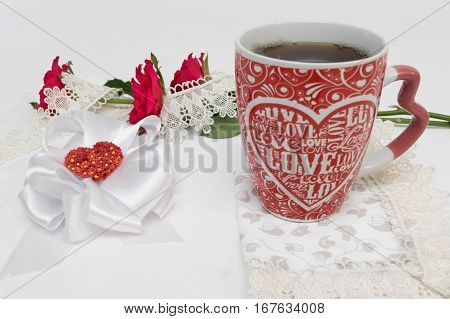 decorations for saint valentine's day with tea cup and rose flowers