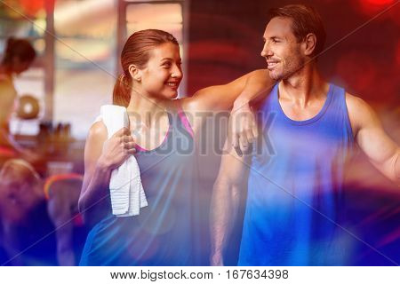Smiling friends standing in gym