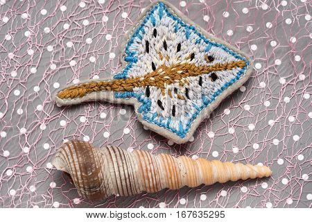 Hand Embroidered Skate On Dots Paper With Seashell