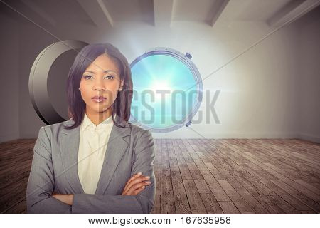 Portrait of confident businesswoman against digital room