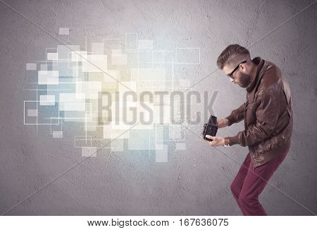 A funny stylish hipster guy capturing bright moments and glowing square pictures with a vintage photo camera illustration concept