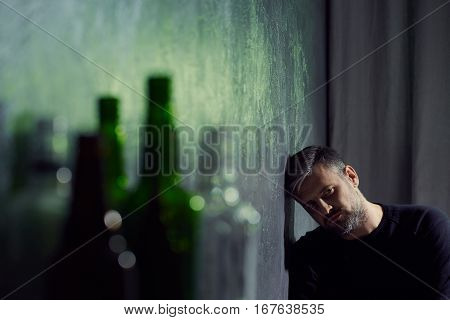 Man With Empty Alcohol Bottles