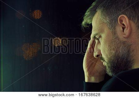 Thoughtful Man Sitting Alone