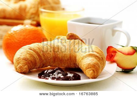 butter croissant and coffee for breakfast - food and drink