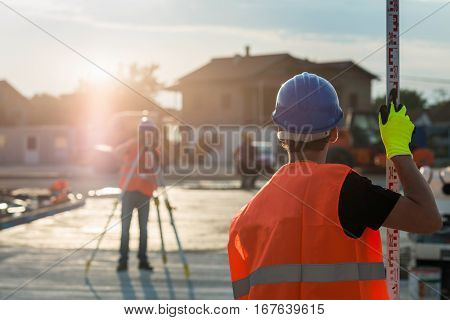 Surveyors on construction site, color image, outdoors
