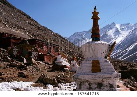 Buddhist ritual structures Stupas at the Buddhist monastery Driraphuk Gompa with altitude 5000 meters above sea level on hillside of Sacred Mount Kailash in Western Tibet.