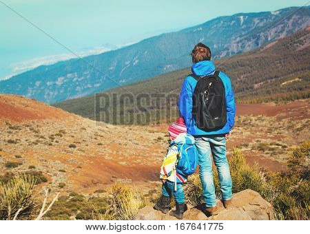 father with little daughter travel in mountains, family travel