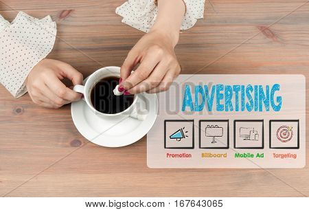 Advertising. Coffee cup top view on wooden table background.