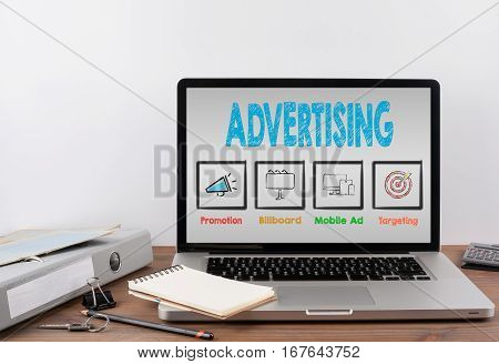 Advertising concept. Office desk with a laptop, gray background