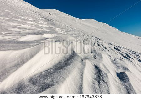 Contrast Between Snow And Blue Sky