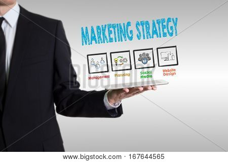 Marketing Strategy concept, young man holding a tablet computer.