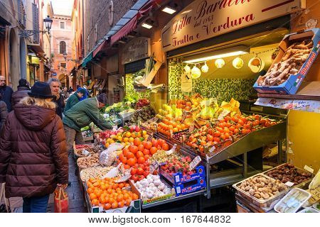 Bologna Italy 05 Jan 2017 - greengrocers displaying their wares in Via Pescherie Vecchie a famous street in the historic center of Bologna