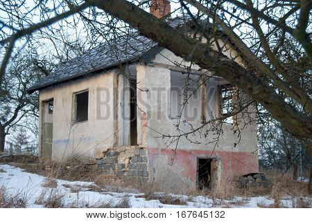Old Abandoned Ruined House In A Garden In Winter