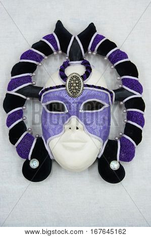 theatrical carnival mask lying on a white background