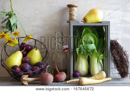 autumn still life with vegetables and fruits (bok choy, parsnips, beetroot, pears and plums