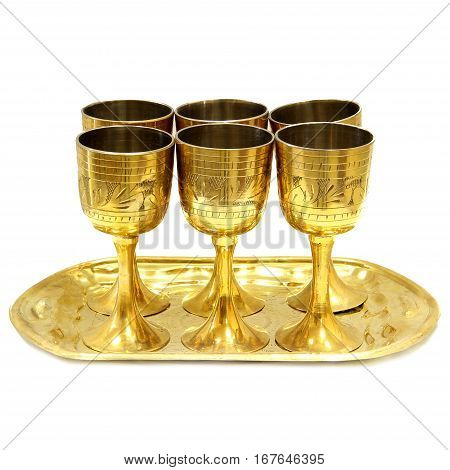gold wine glasses on a tray. White background