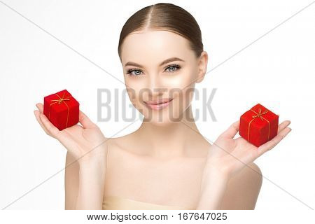 Woman Beautiful model with red boxes with gold ribbons with gifts in his hands. Presents for a holiday, birthday or Christmas