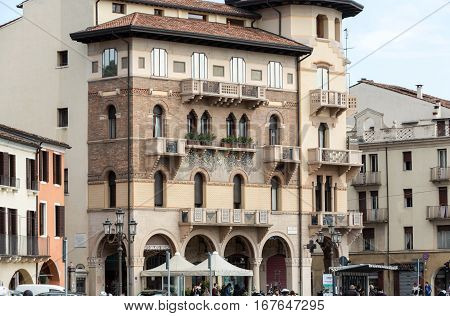 PADUA, ITALY - MAY 3, 2016: The old residential houses decorated with mosaic tiles and pattern maid from bricks Prato della Valle in Padua. Italy