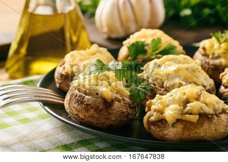 Baked mushroom caps stuffed with creams cheese, garlic and herbs.