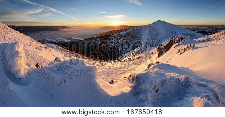 Colorful winter sunrise in mountains panorama in Slovakia.