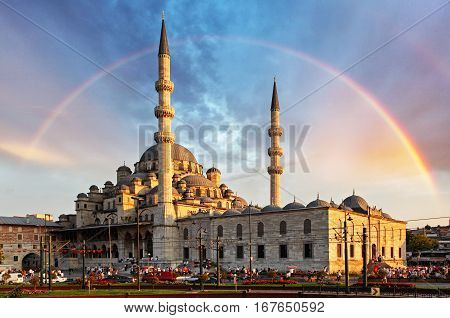 Istanbul - New Mosque Yeni Cami in the evening with Rainbow Eminonu district Turkey