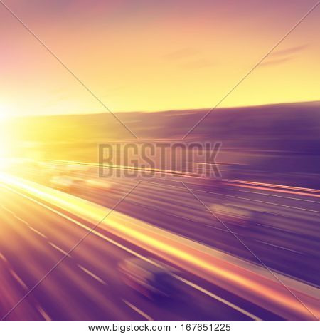Motion blurred cars on highway during sunset.
