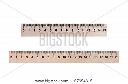 Two lines of wood 20 and 15 centimeters on a white background, isolated. Stationery, education