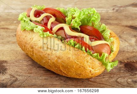 Hot Dog With Lettuce,tomatoes And Cucumber On Wooden Board