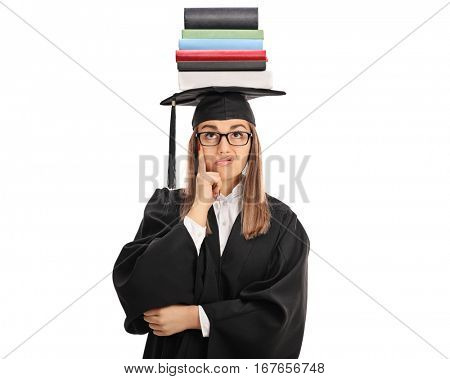 Upset graduate student with a stack of books on top of her head isolated on white background
