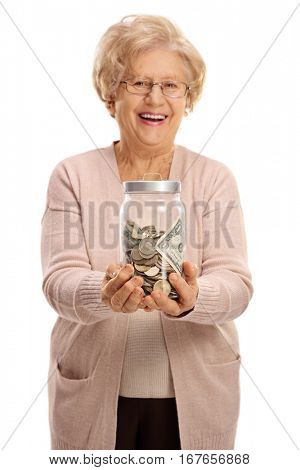 Overjoyed mature woman holding a jar filled with money isolated on white background