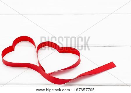 Hearts Of Red Ribbon On White Wooden Background. Top View.