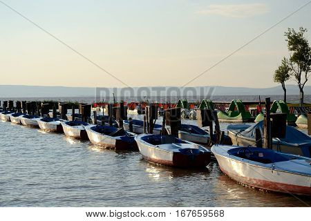 Pedal boats and motor boats have been laid out at the footbridge - lake neusiedl austria