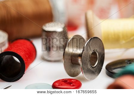 Thread Spools, Thimbles And Other Items For Sewing Close-up Shot