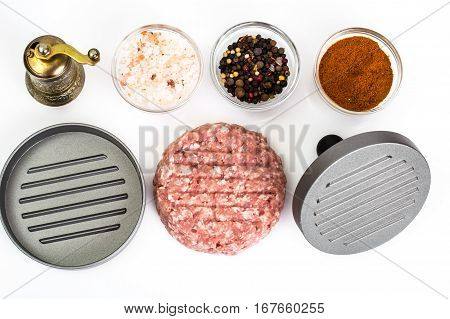Stuffing and press for burger on white background. Studio Photo
