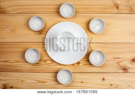 Empty Ceramic Dishware On A Wooden Table, Top View