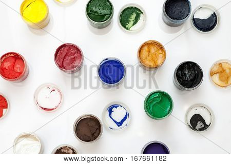 Open Gouache Jars On A White Background, Flat Lay Composition, Top View