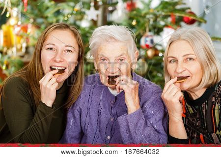 Photo of elderly woman and her carers having fun