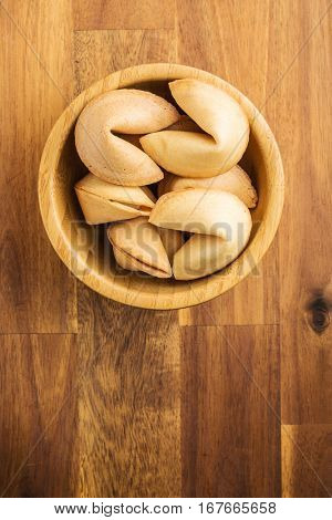 The fortune cookies in wooden bowl.
