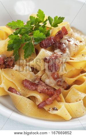 Italian pasta carbonara, pappardelle with pancetta bacon, cheese and egg sauce