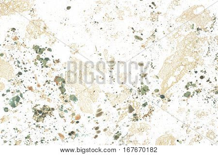 Abstract background with spots of brown and green paint