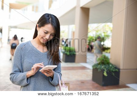 Woman looking at mobile phone in Shopping mall