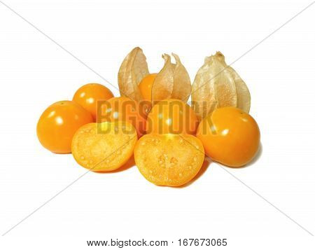 Bunch of vibrant yellow ripe Cape gooseberries, some with calyx, some whole, some cut in half isolated on white background