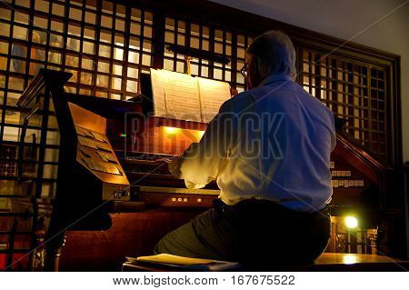 Organist Playing A Organ