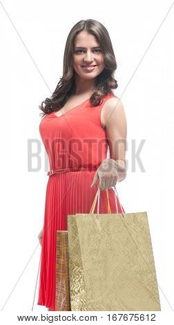 attractive young brunette woman in red dress with shoping bags isolated on white background