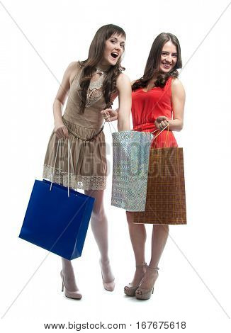 Two attractive girls with shopping bags isolated on white background