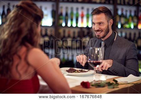 Gala dinner for charming man and his girlfriend in restaurant