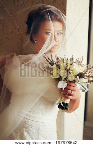Bride Looks Mysterious Being Hidden Behind A Veil