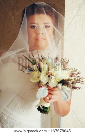 Bride With Pride In Her Eyes Stand Under A Veil