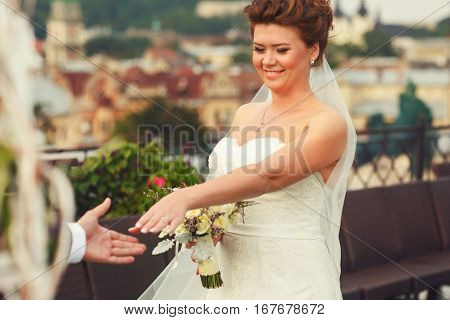 Joyful Bride Shows Her  Engagement Ring To The Guests On A Roof-top